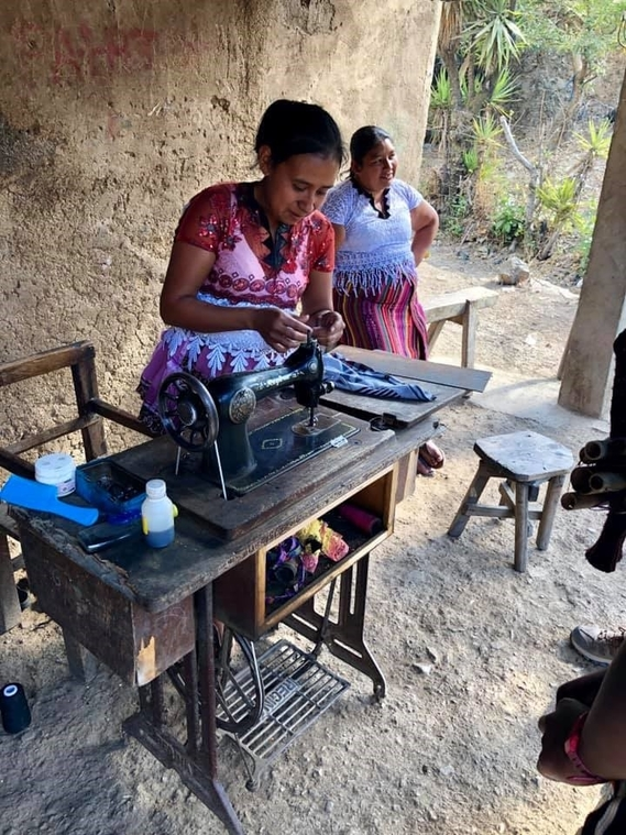 Woman sewing in the village
